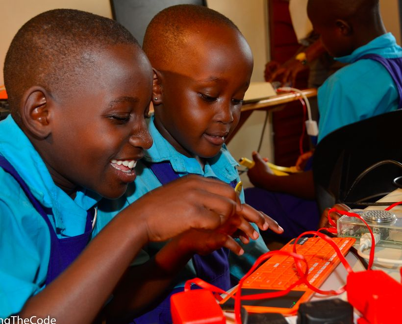 <strong><em>Girls learning to code and build a computer at Theirworld Code Club, Women in Technology Uganda. </em></strong>
