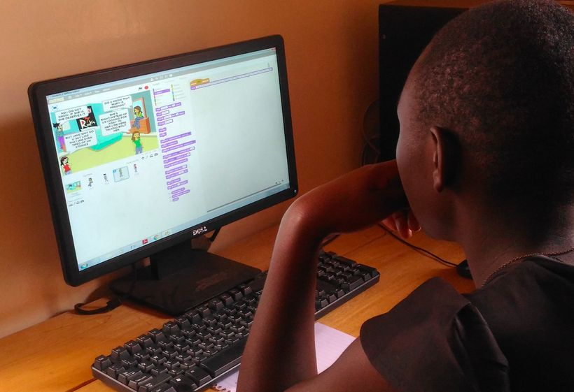 <strong>Rosemary using 'Scratch' at Theirworld Code Club, Women in Technology Uganda. </strong>