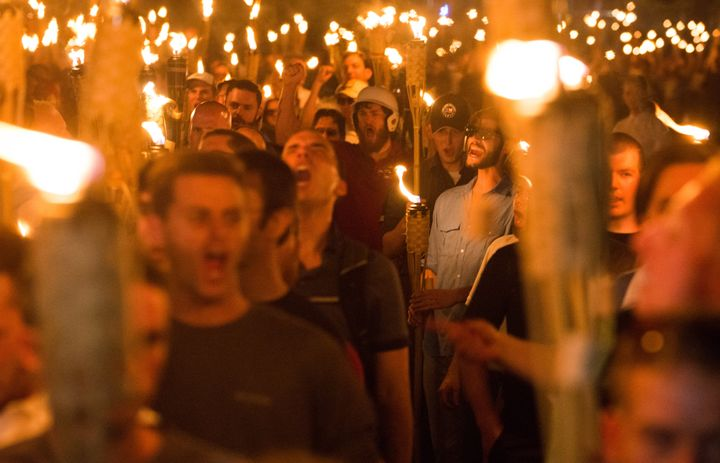 White supremacists march through the University of Virginia campus in Charlottesville on Aug. 11, 2017, the night before hold