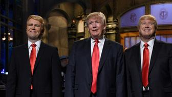 SATURDAY NIGHT LIVE -- 'Donald Trump' Episode 1687 -- Pictured: (l-r) Taran Killam, Donald Trump, and Darrell Hammond during the monologue on November 7, 2015 -- (Photo by: Dana Edelson/NBC/NBCU Photo Bank via Getty Images)