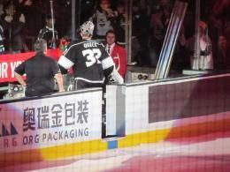 Los Angeles Kings player Jonathan Quick exits the ice near an advertisement for China's O.R.G. Packaging, which became a spo