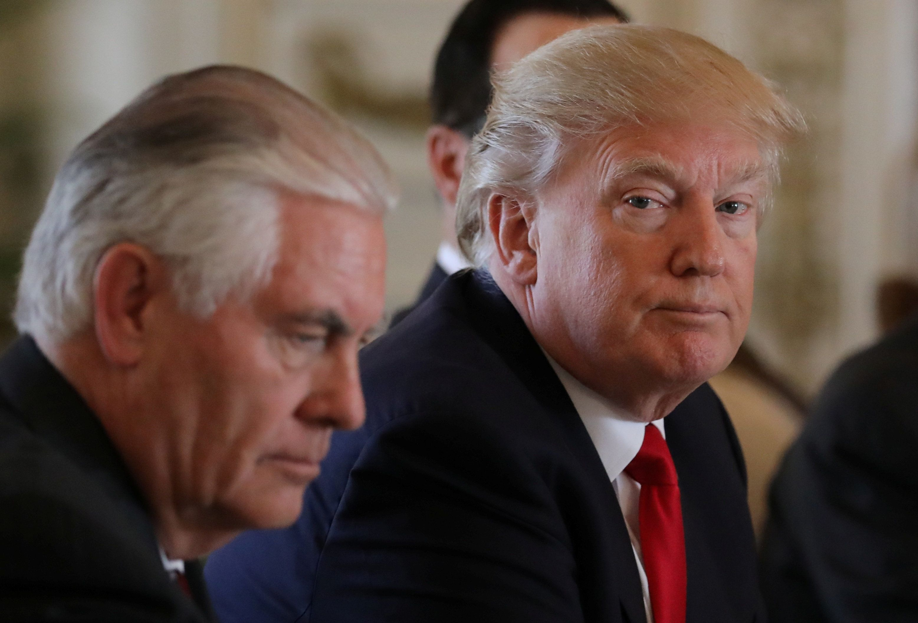 U.S. President Donald Trump (R) sits next to Secretary of State Rex Tillerson during a bilateral meeting with China's President Xi Jinping (Not Pictured) at Trump's Mar-a-Lago estate in Palm Beach, Florida, U.S., April 7, 2017.   REUTERS/Carlos barria