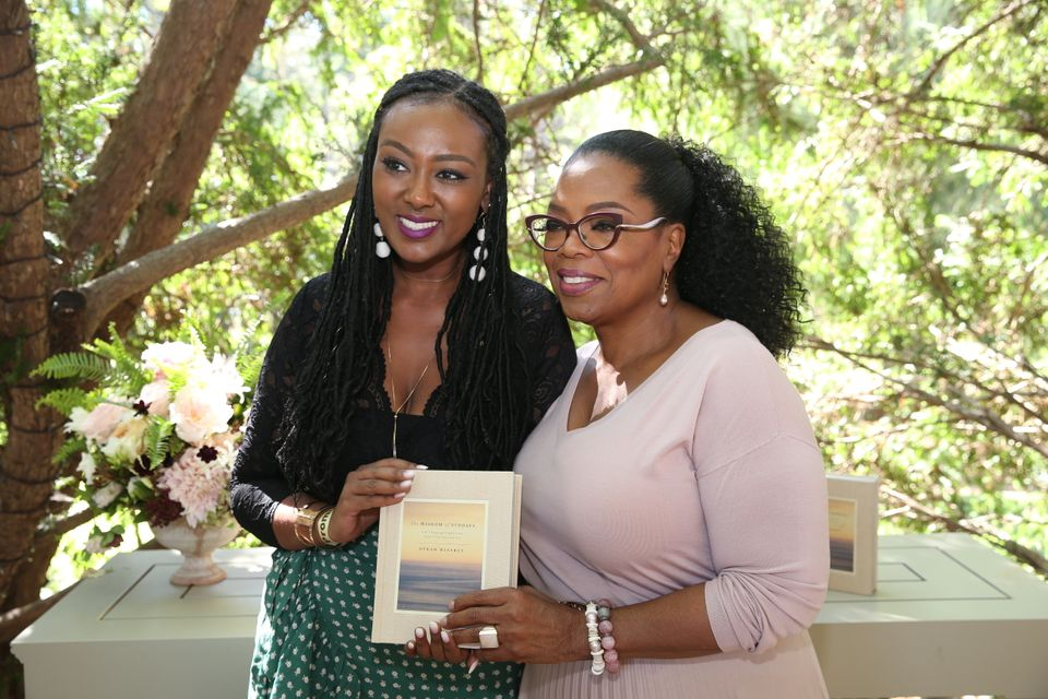 I stand beside Oprah as we pose with her latest book,