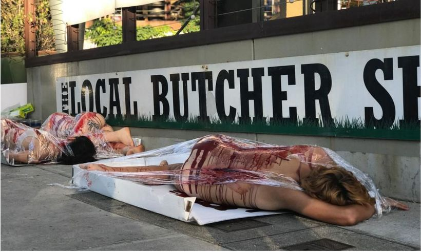A DxE protest in front of a Berkeley butcher shop.