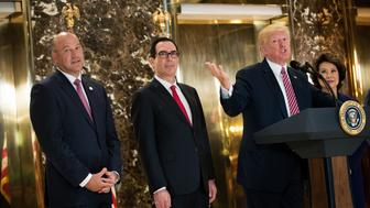 NEW YORK, NY - AUGUST 15: President Donald Trump delivers remarks following a meeting on infrastructure at Trump Tower, August 15, 2017 in New York City. Standing alongside him from L to R, Director of the National Economic Council Gary Cohn, Treasury Secretary Steve Mnuchin, and Transportation Secretary Elaine Chao. He fielded questions from reporters about his comments on the events in Charlottesville, Virginia and white supremacists. (Photo by Drew Angerer/Getty Images)