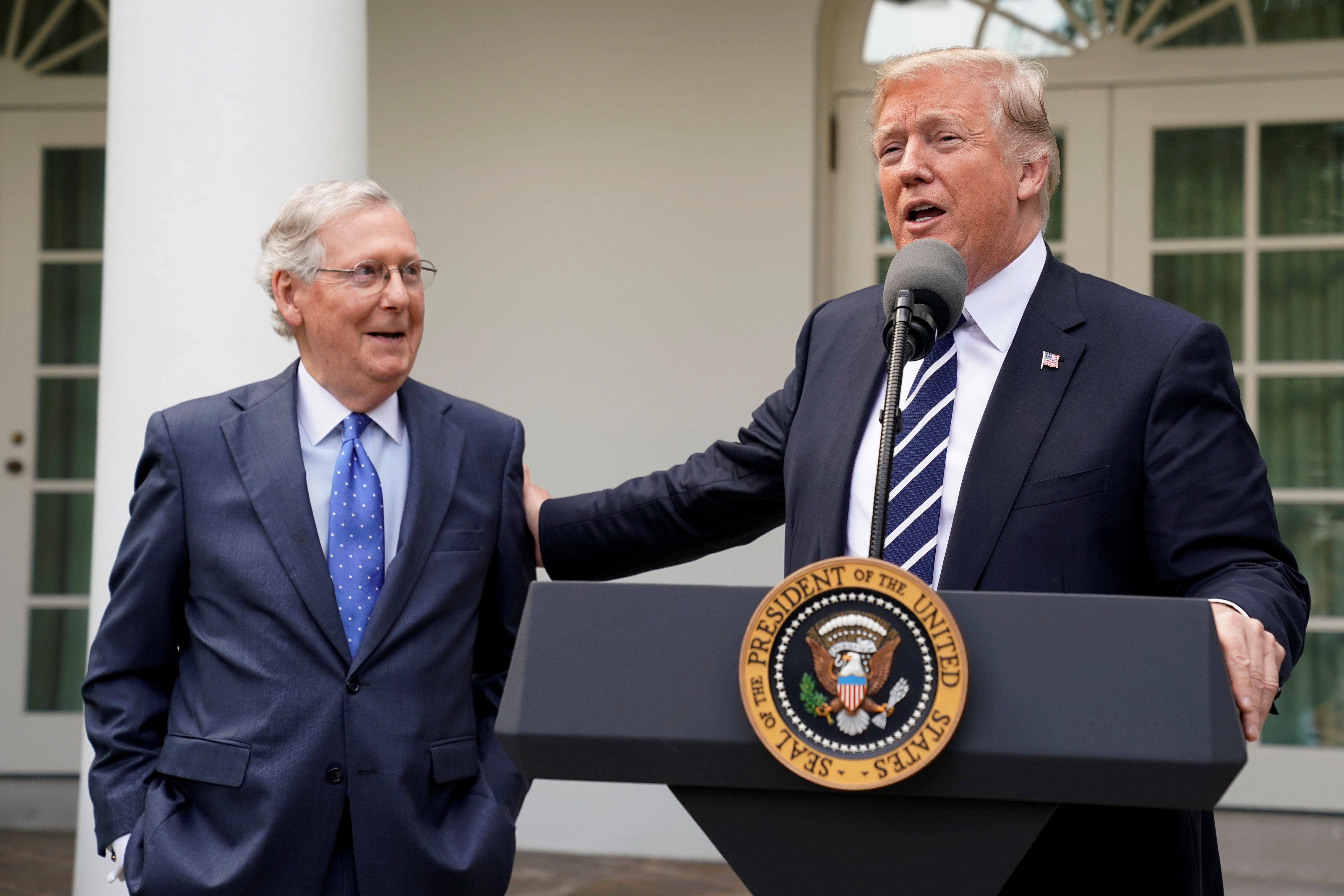U.S. President Donald Trump speaks to the media with U.S. Senate Majority Leader Mitch McConnell at his side in the Rose Garden of the White House in Washington, U.S., October 16, 2017. REUTERS/Yuri Gripas