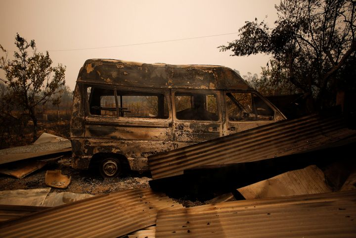A burned-out vehicle was left behind by a forest fire near Vale do Couco, Portugal, on Oct. 16, 2017.
