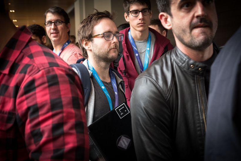 Developers rush to various judging rooms to present the software they built during the weekend.