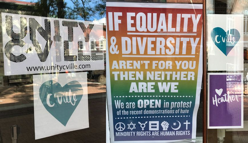 "Signs posted throughout Charlottesville's downtown area in September, a month after the violence of the ""Unite the Right"" ral"