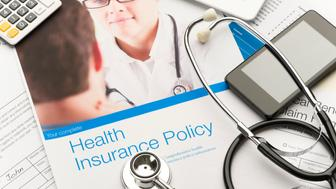 Health Insurance Policy brochure with paperwork. There is also a stethoscope, mobile phone and digital tablet in the image. The included image can also be found in my portfolio. Image # 22268159