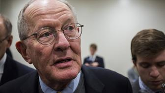 Senator Lamar Alexander, a Republican from Tennessee, speaks to members of the media while heading to a roll call vote on Capitol Hill in Washington, D.C., U.S., on Wednesday, Oct. 18, 2017. A bipartisan deal to prop up Obamacare exchanges has 'stalled out,' a top Senate Republican said Wednesday as President Donald Trump signaled his opposition. Photographer: Zach Gibson/Bloomberg via Getty Images