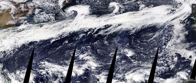 The composite image above, released by NASA, shows a large atmospheric river stretching from China on...