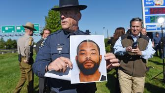 Harford County Sheriff Jeffrey Gahler shows a picture of suspect Radee Labeeb Prince, 37, after a news conference near the scene of a workplace shooting where five people were shot and three are confirmed dead Wednesday, Oct. 18, 2017 in Edgewood, Md. The shooting was at the Advanced Granite Solutions inside Emmorton Business Park. (Kenneth K. Lam/Baltimore Sun/TNS via Getty Images)