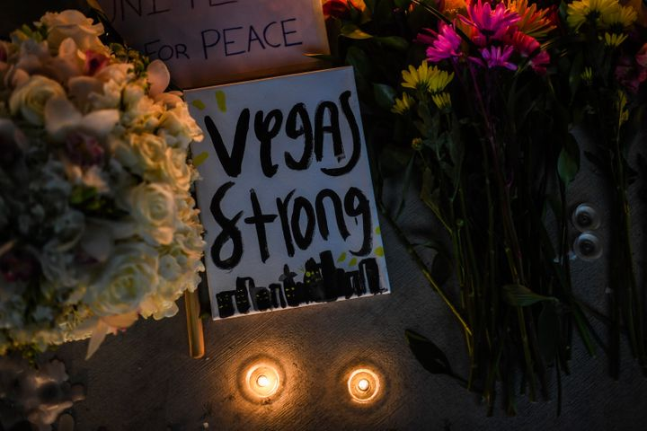 Flowers and signs are seen at a vigil that was held for the victims along the Las Vegas Strip a day after 59 people were kill