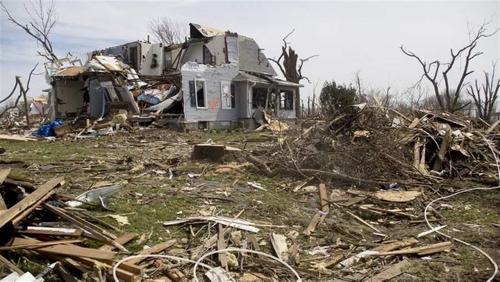 Residents of Fairdale, Illinois, took a direct hit from a tornado, which left this home devastated. Insurance officials warn