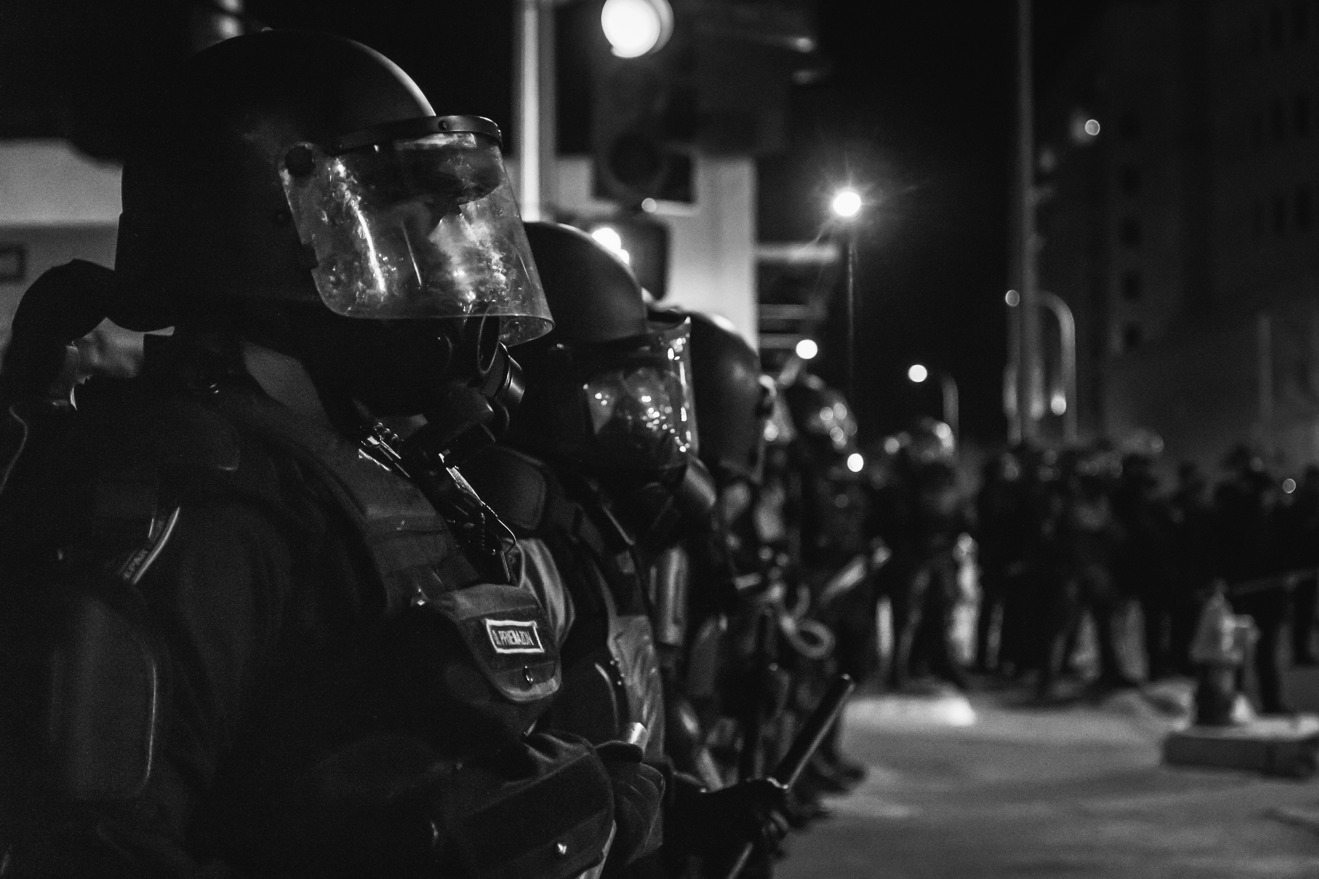 Albuquerque police officers observe a protest in March 2014, just weeks before the U.S. Department of Justice released a
