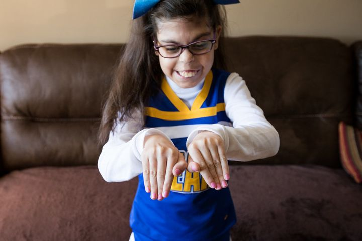 "Gianna was diagnosed with <a href=""https://ghr.nlm.nih.gov/condition/22q112-deletion-syndrome"" target=""_blank"">22q11.2 deletion syndrome</a>&nbsp;in utero. Although she has had 26 surgeries, she&nbsp;is still able to participate in her town's general cheering squad."