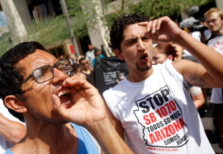 Demonstrators protest against Arizona's controversial Senate Bill 1070 immigration law outside Sheriff Joe Arpaio's office in Phoenix on July 29, 2010.