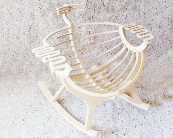 This unique, wooden rocking chair has a smooth finish. It's perfect for new moms who want to spice up the traditio