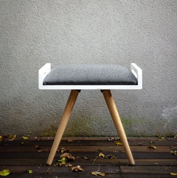 This modern bench is made of solid oak with a wool upholstered cushion. It offers great versatility to be used as seatin