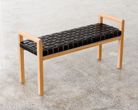 This bench combines a minimalist oak frame with rich woven straps of leather. The bench can easily work for an entryway, bedr