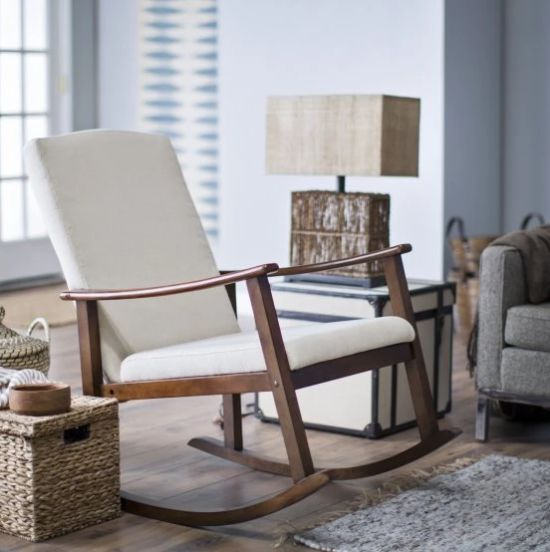 This rocking chair has a durable solid birch wood frame and curved armrests for added comfort and support. Get it at <a href=
