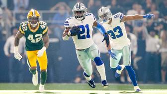 ARLINGTON, TX - OCTOBER 08: Dallas Cowboys running back Ezekiel Elliott (21) rushes during the football game between the Green Bay Packers and Dallas Cowboys on October 8, 2017 at AT&T Stadium in Arlington, TX.  (Photo by Andrew Dieb/Icon Sportswire via Getty Images)