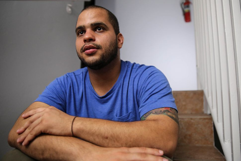 Christian Romero talks to HuffPost from the stairwell of his apartment complex on Oct. 14, 2017 in Carolina, Puerto Rico.&nbs