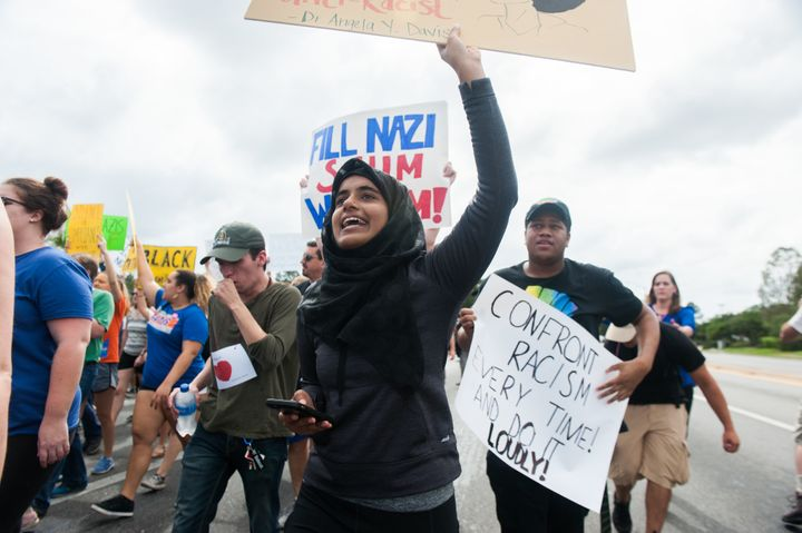 Nushrat Nur, a student at the University of Florida in Gainesville, marches down 34th street.