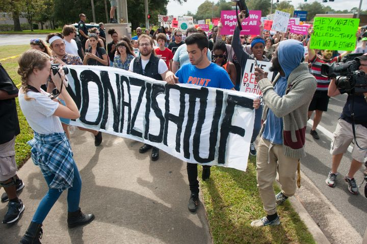People march down 34th street to the entrance to the University of Florida.