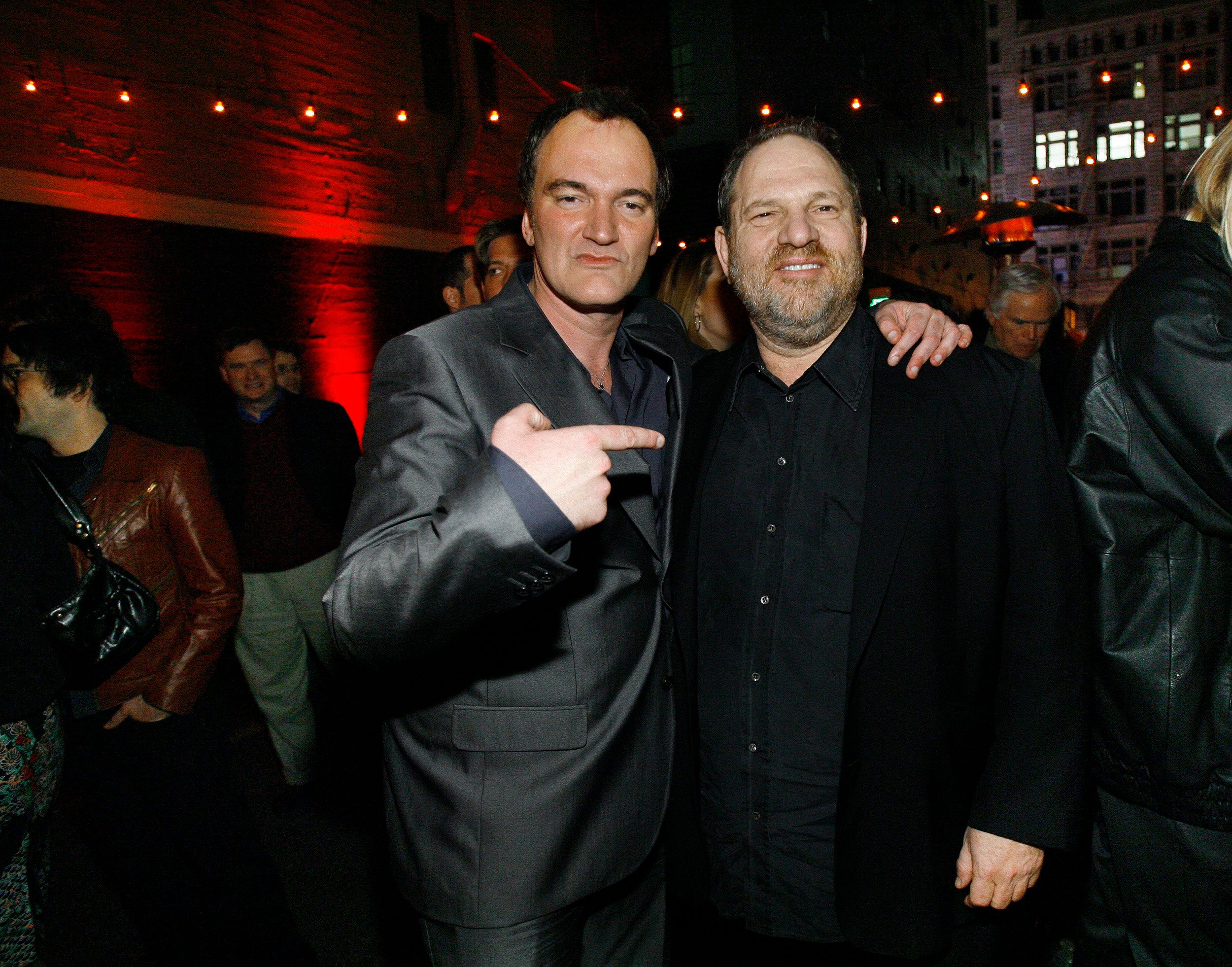 "Director Quentin Tarantino (L) points at producer Harvey Weinstein at the after-party for the premiere of ""Grindhouse"" in Los Angeles March 26, 2007. The movie features two full length horror movies, ""Death Proof"" and ""Planet Terror"", written and directed respectively by Quentin Tarantino and Robert Rodriguez. The movie opens in the U.S. on April 6. REUTERS/Mario Anzuoni (UNITED STATES)"