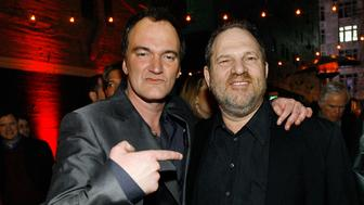 """Director Quentin Tarantino (L) points at producer Harvey Weinstein at the after-party for the premiere of """"Grindhouse"""" in Los Angeles March 26, 2007. The movie features two full length horror movies, """"Death Proof"""" and """"Planet Terror"""", written and directed respectively by Quentin Tarantino and Robert Rodriguez. The movie opens in the U.S. on April 6. REUTERS/Mario Anzuoni (UNITED STATES)"""