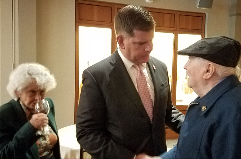 Boston Mayor Marty Walsh speaks with Holocaust survivors Margot Segall-Blank and Sam Weinreb.