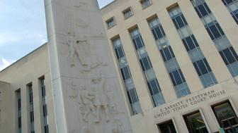 A general view shows the exterior of the Prettyman Federal Court House in Washington August 17, 2006. A federal judge on Thursday ruled in the court house that cigarette makers were liable for a decades-long conspiracy to hide the dangers of smoking but declined to impose financial penalties on the industry. REUTERS/Jonathan Ernst   (UNITED STATES)