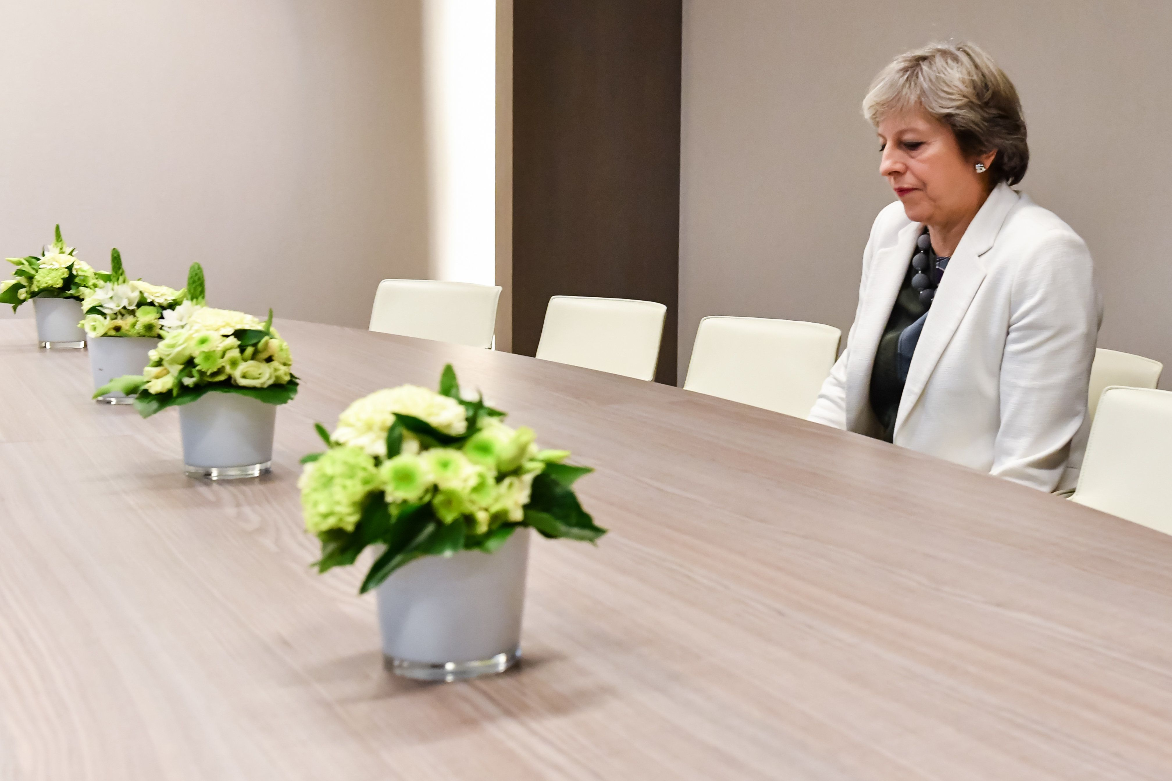 Theresa May Sitting Alone At A Table In Brussels Is The Meme That Writes