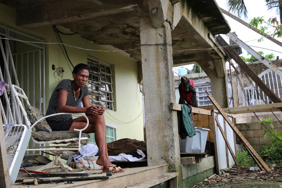 Juana Ferrera sits on the porch of her home in Valle Hill,Canóvanas, Puerto Rico.