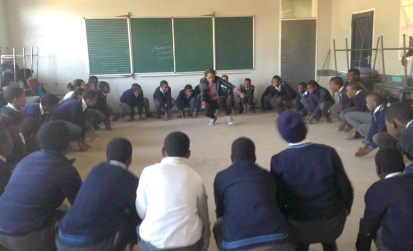 <em>Lorato, Young 1ove's Training Officer, energizes a group of students during programming</em>