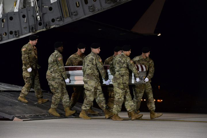 A U.S. Army carry team transfers the remains of Army Staff Sgt. Dustin Wright of Lyons, Georgia, at Dover Air Force Base in D
