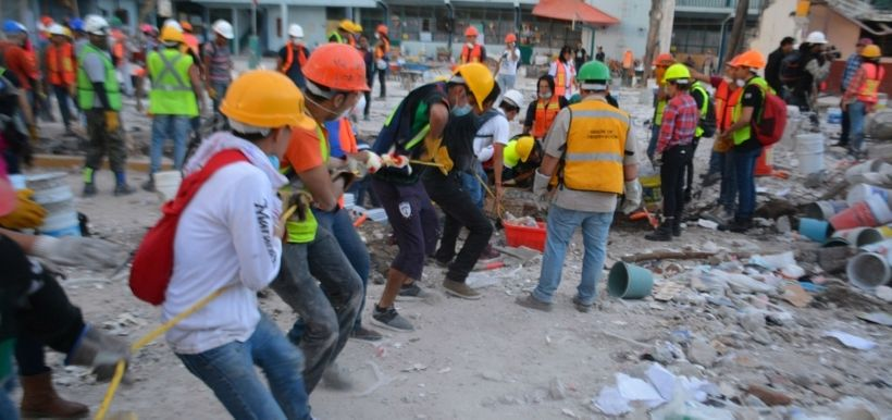 Volunteers work in the wreckage of a demolished building after the recent Mexico City earthquake.