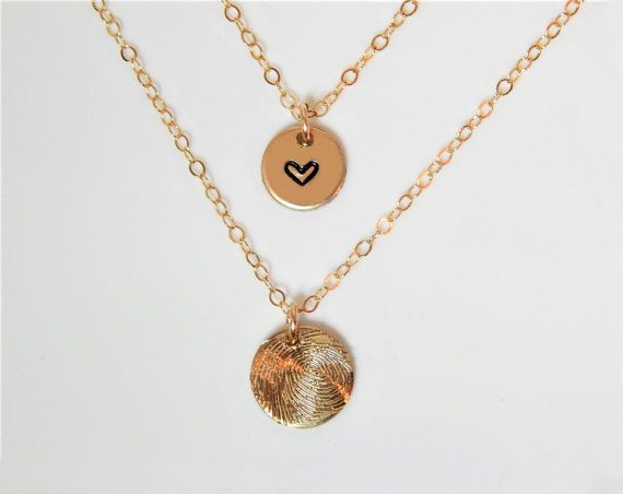 """Get them this cute necklace from <a href=""""https://www.etsy.com/listing/494362239/fingerprint-necklace-actual-fingerprint?gpla"""