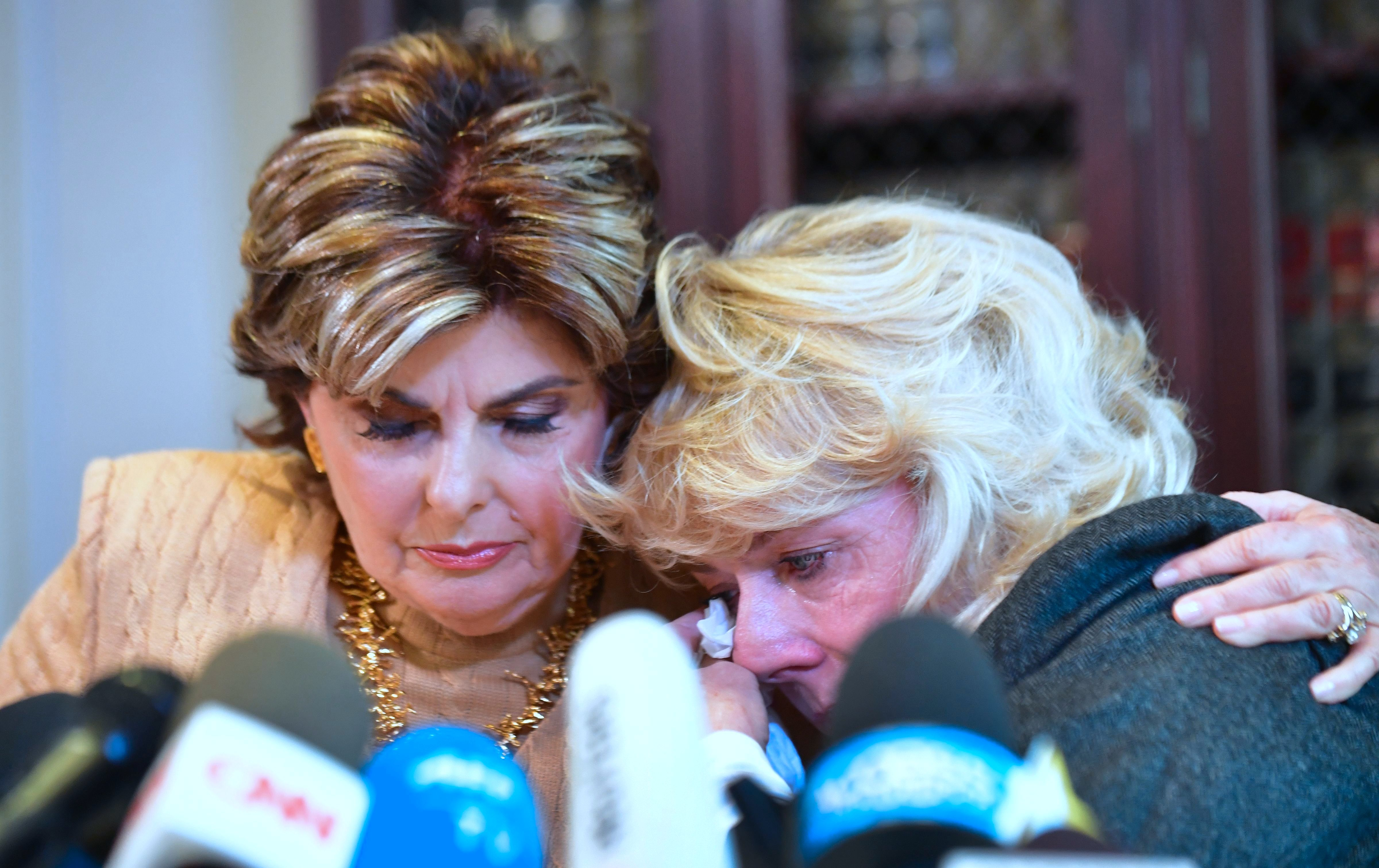 Heather Kerr, right, reacts afteralleging in anews conference that she was sexually harassed by film producer Har