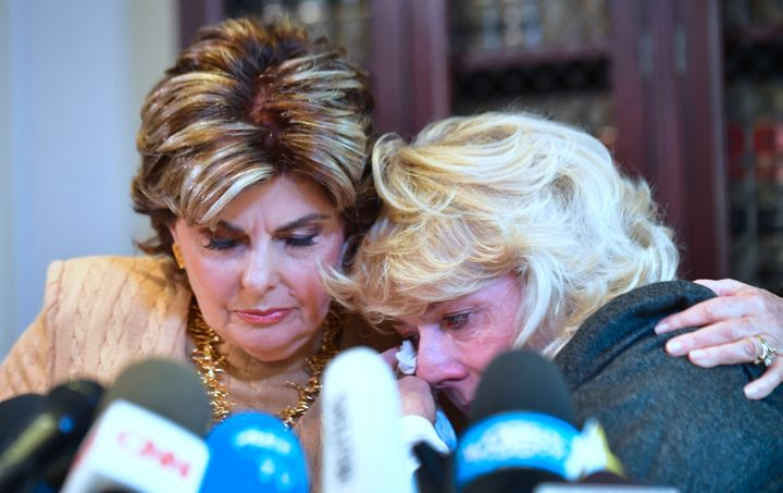 Heather Kerr, right, reacts after alleging in a news conference that she was sexually harassed by film producer Har