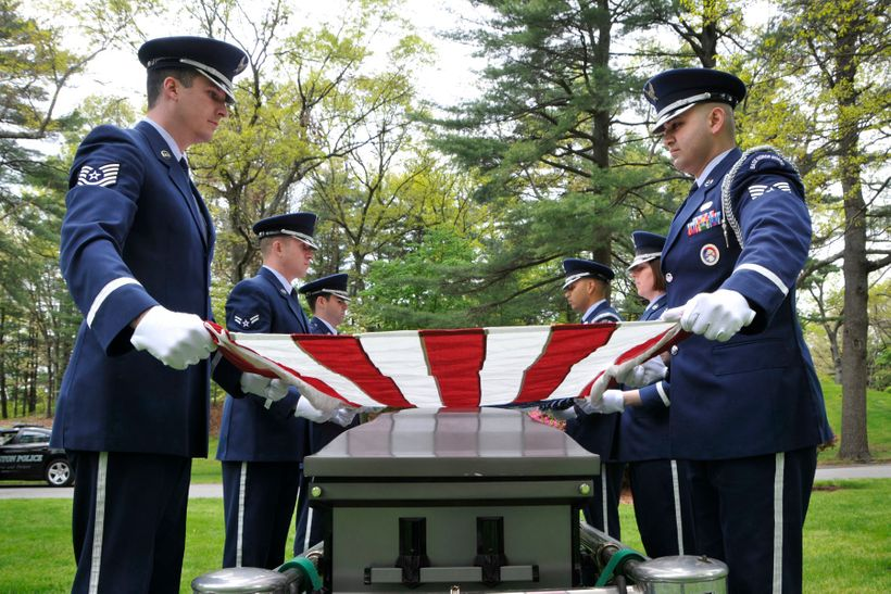 A military honor guard perform a seven-member funeral detail at a cemetery in Massachusetts in 2012.