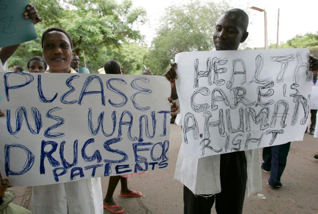 Zimbabwean doctors and nurses hold placards during a demonstration over the deteriorating health system,...