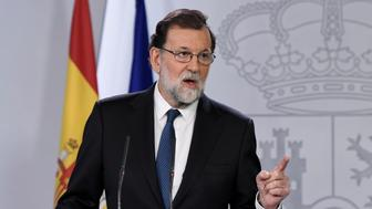 Spanish Prime Minister Mariano Rajoy gives a press conference after a crisis cabinet meeting at the Moncloa Palace on October 21, 2017 in Madrid.  Spain's government said that it will move to suspend Catalonia's separatist government and call fresh elections in the region in a bid to stop its leaders from declaring independence. Speaking after an emergency cabinet meeting, Rajoy said his government had no choice after Catalonia's separatist government acted in a way that was 'unilateral, contrary to the law and seeking confrontation' in holding a banned independence referendum.   / AFP PHOTO / GABRIEL BOUYS        (Photo credit should read GABRIEL BOUYS/AFP/Getty Images)