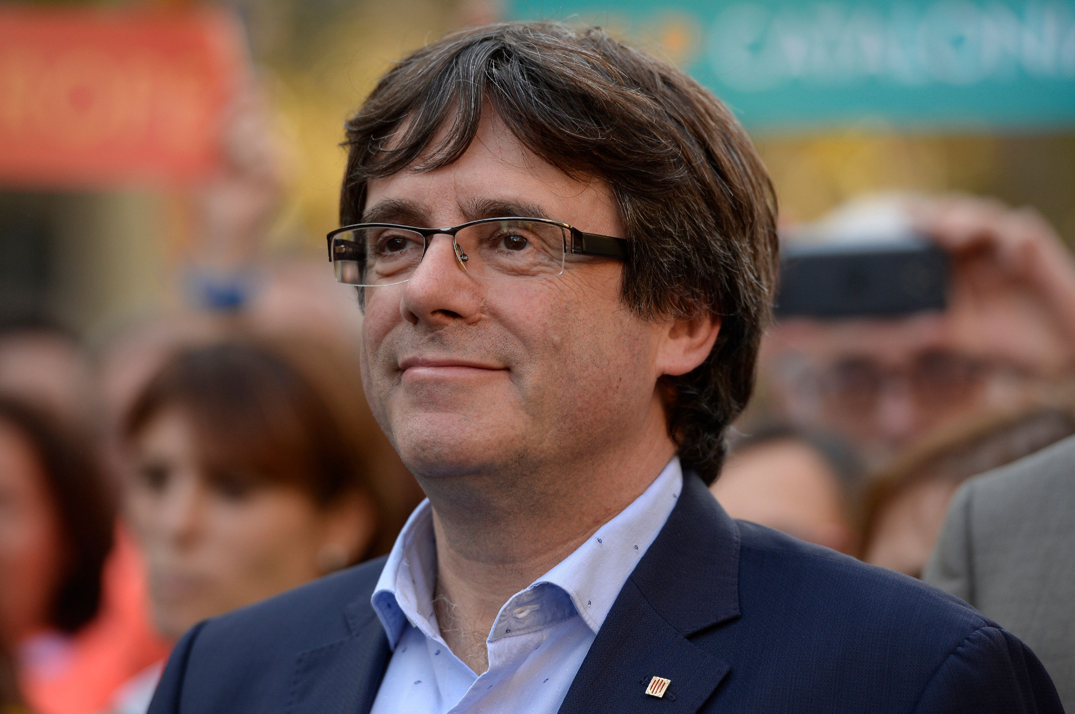 ?Catalan regional president Carles Puigdemont attends a demonstration on October 21, 2017 in Barcelona, to support two leaders of Catalan separatist groups, Jordi Sanchez and Jordi Cuixart, who have been detained pending an investigation into sedition charges. Spain announced that it will move to dismiss Catalonia's separatist government and call fresh elections in the semi-autonomous region in a bid to stop its leaders from declaring independence. / AFP PHOTO / Josep LAGO        (Photo credit should read JOSEP LAGO/AFP/Getty Images)