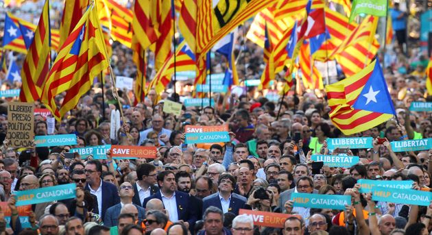 Puigdemont and other Catalan regional government members attend a demonstration organized by Catalan...