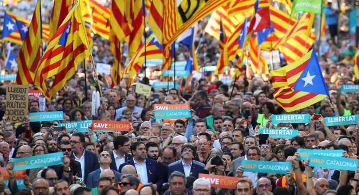 Puigdemont and other Catalan regional government members attend a demonstration organized by Catalan pro-independence mo