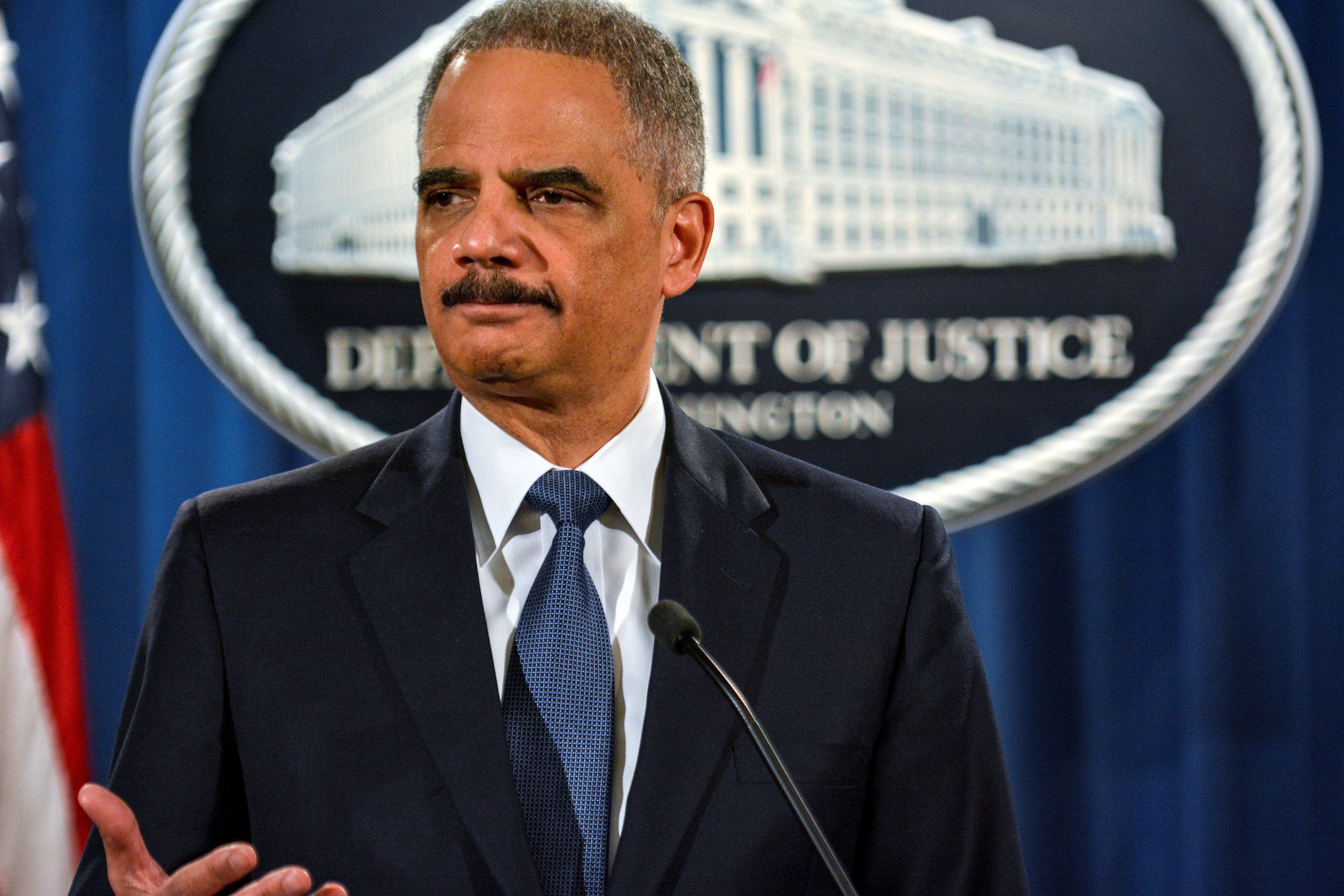FILE PHOTO: Then U.S. Attorney General Eric Holder addresses a Justice Department news conference in Washington, U.S., March 4, 2015. To match OBAMA-LAWYERS/ REUTERS/James Lawler Duggan/Files