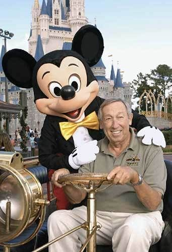 Roy E. Disney poses for a picture with  Mickey Mouse in front of Cinderella Castle at WDW's Magic Kingdom